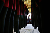 A man going canyoning and wetsuits hung-up in a row, Haiming, Tyrol, Austria