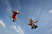 Boy and girl (5-6 years) on a swing