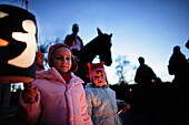 Children carrying lanterns for the St. Martin festival with St. Martin on a horse, Degerndorf, Upper Bavaria, Germany