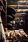 Frying pans and cooking pots with Woodpiles, Restaurant Karseggalm, Salzburger Land, Austria