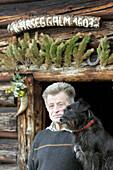 Senior Dairyman Josef Gruber with Dairydog Spetz, Entrance Karseggalm, Nationalpark Hohe Tauern, Salzburger Land, Austria
