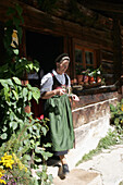 Mature woman serving juice,Restaurant Maurachalm, Nationalpark Hohe Tauern, Salzburger Land, Austria