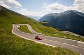 Car driving along the Grossglockner High Alpine Road, Hochalpenstrasse, Mountain Pass, Carinthia, Austria