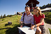 Couple reading map near Lammersdorfer Hut, 1650 m, Lammersdorf near Millstatt, Carinthia, Austria