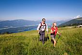 Couple hiking above Millstaetter See, near Millstatt, Carinthia, Austria