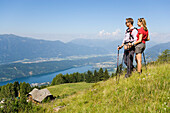 Couple enjoying the view over the Millstaetter See, 1650 m the deepest lake in Carinthia, Lammersdorf near Millstatt, Carinthia, Austria