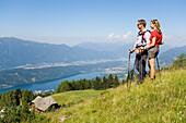 Couple enjoying the view over the Millstaetter See, 1650 m the deepest lake in Carinthia, Lammersdorf near Millstatt, Carinthia, Austria