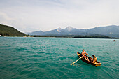 Young couple in a rowing boat on Lake Faak, Carinthia, Austria