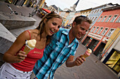 Young couple eating an ice cream, Villach, Carinthia, Austria