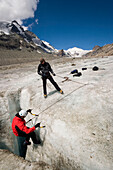 Climber abseiling in a crevasse of the Pasterze glacier  (the biggest glacier of Austria), Franz Josephs Höhe (2369 m), Großglockner (3798 m, highest mountain of Austria), Carinthia, Austria