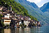 View over Lake Lugano to picturesque village Gandria at mountainside of mount Monte Bre, Lugano, Ticino, Switzerland