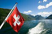 Motorboat with Swiss Flag on Lake Lugano, Lugano, Ticino, Switzerland