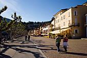 View along harbour promenade with pavement cafes, Ascona, Lago Maggiore, Ticino, Switzerland