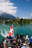 Excursion boat leaving Spiez, view to castle and castle church of Spiez, Lake Thun, Bernese Oberland (highlands), Canton of Bern, Switzerland