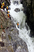 Group canyoning through Saxeten gorge, Saxeten, Bernese Oberland, Canton of Bern, Switzerland