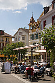 People sitting in a pavement cafe, Interlaken, Bernese Oberland (highlands), Canton of Bern, Switzerland