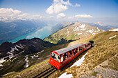 Brienz Rothorn Railway, Switzerlands oldest cogwheel railway, driving uphill, Lake Brienz in the background, Brienz, Bernese Oberland, Canton of Bern, Switzerland
