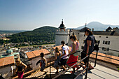 Group of tourists visiting Hohensalzburg Fortress, largest, fully-preserved fortress in central Europe, Salzburg, Salzburg, Austria, Since 1996 historic centre of the city part of the UNESCO World Heritage Site