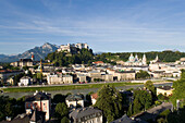 View over Salzach to Old Town with Hohensalzburg Fortress, largest, fully-preserved fortress in central Europe, Salzburg Cathedral, Franciscan Church and Collegiate Church, built by Johann Bernhard Fischer von Erlach, European Alps in background, Salzburg