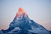 Matterhorn (4478 metres) and fool moon, Zermatt, Valais, Switzerland