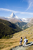 Couple hiking, enjoying the view to the Matterhorn (4478 metres), Sunnegga, Zermatt, Valais, Switzerland