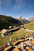 View over a terrace of a mountain restaurant ot the Matterhorn (4478 m), Findeln, Zermatt, Valais, Switzerland