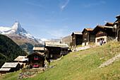Wooden alpine houses of a mountain village, Findeln, Matterhorn 4478 m in the background, Zermatt, Valais, Switzerland