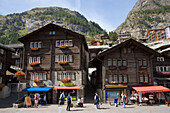 Tourists walking over Bahnhofplatz, Zermatt village, Zermatt, Valais, Switzerland