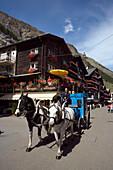 Carriage passing Bahnhofstrasse, Zermatt village, Zermatt, Valais, Switzerland
