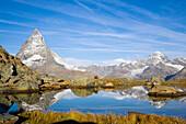East side (Hörnligrat) of Matterhorn (4478 m) reflected in Riffelsee, Zermatt, Valais, Switzerland