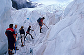 Hiking tour on Franz Fosef Glacier, one of the few growing glaciers, New Zealand