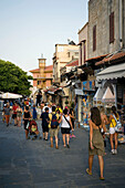 People strolling along shopping street Odos Sokratous, Rhodes Town, Rhodes, Greece, (Since 1988 part of the UNESCO World Heritage Site)