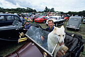 Man and Dog in Oldtimer, Northiam Steam and Country Fair, Northiam, East Sussex, England, Great Britain