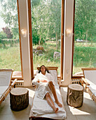 Woman relaxing, Hotel Neuklostersee, Nakenstorf, Mecklenburg-Western Pomerania, Germany, MR, PR