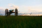 Cannon on a former battlefield at sundown, Manassas, Virginia, USA
