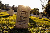 A gravestone on lawn, National Cemetery, Virginia, USA
