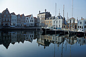 Sailing boats are moored at the deserted Goes harbour, Goes, Zeeland Province, Netherlands, Europe