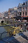 Bikes on a bridge and houses along Oude Gracht, Utrecht, Netherlands, Europe