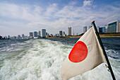 Japanese Flag with Tokyo Bay, Tokyo, Japan