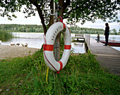 Life saver, mother and child on the jetty of Neuklostersee, Wellness Hotel, Spa Hotel Seehotel Neuklostersee, Mecklenburg - Western Pomerania, Germany