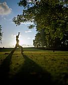 Woman exercising yoga, Hameln, Weser Hilly Region, Lower Saxony, Germany