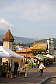 Farmer's market at entry of the Kapellbrücke (chapel bridge, oldest covered bridge of Europe) and Wasserturm, Lucerne, Canton Lucerne, Switzerland