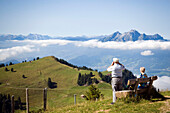Senior couple enjoying view over Rigi Kulm (1797 m) to Pilatus (2132 m), Rigi Kulm, Canton of Schwyz, Switzerland