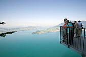 People standing at vantage point of Felsenweg and looking over Lake Lucerne, Bürgenstock (1128 m), Bürgenstock, Canton Nidwalden, Switzerland