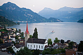 Parish church St. Maria, paddle wheel steamer on Lake Lucerne, Weggis, Canton Lucerne, Switzerland