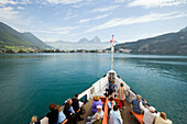 Passengers sitting on the deck of a paddle steamer, Lake Lucerne, Brunnen, Canton of Schwyz, Switzerland