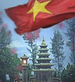 Pagoda in garden of Dai Hung Temple, vietnamese flag, Hue, Vietnam, Indochina