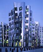 Duesseldorf, futuristic building by architect Frank O  Gehry  Neuer Zollhof Medienhafen