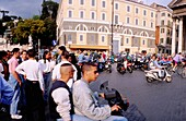 Teenagers on motorbikes, Piazza del popolo, Rome, Italy