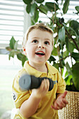 Child lifting a dumbbell